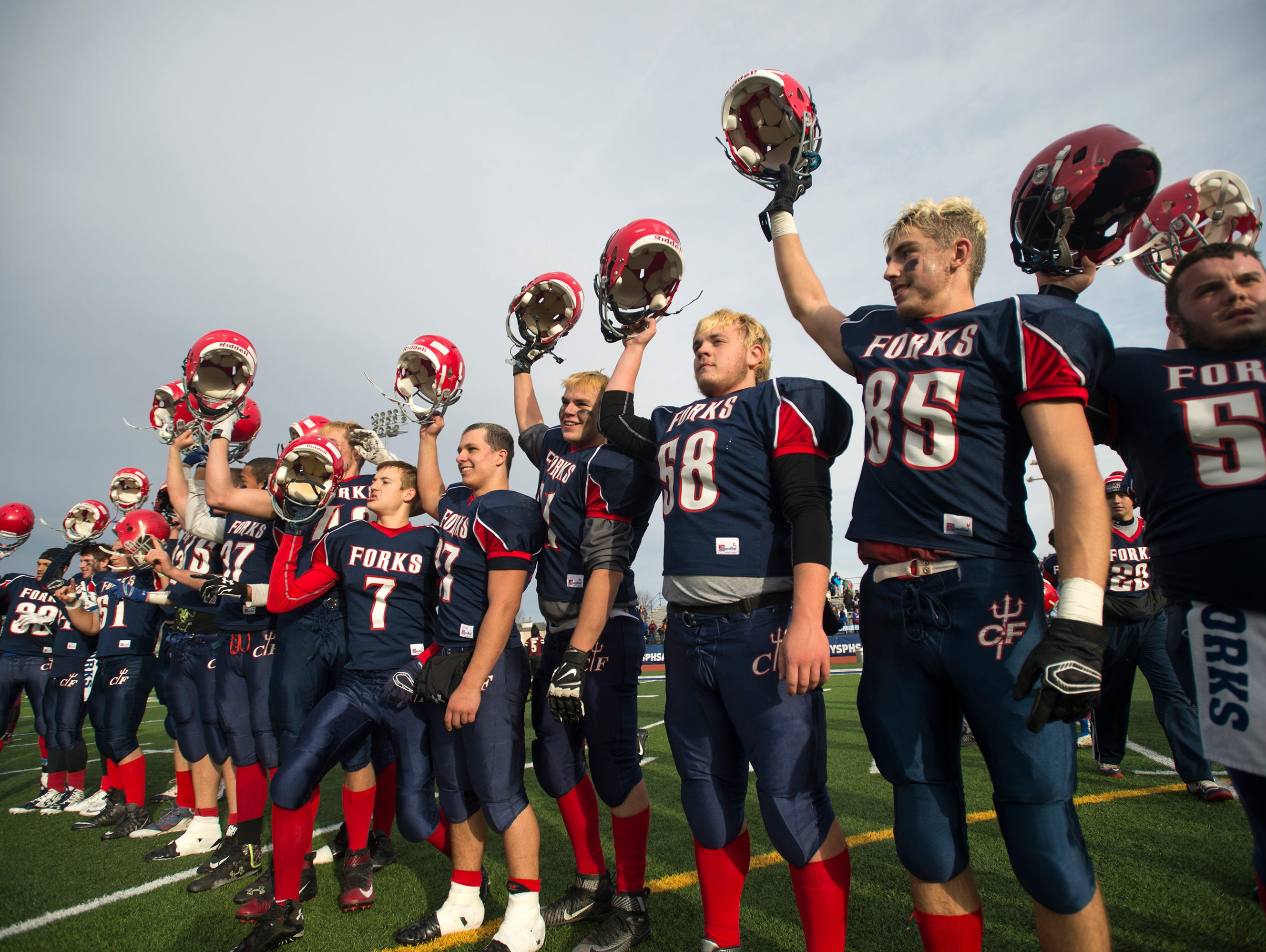 Chenango Forks players celebrate after beating Bath 44-22 to advance to the Class C state playoff finals.