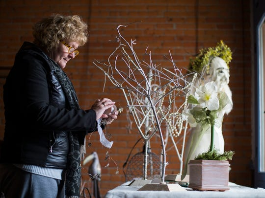 Sherrie Stebbins Rinker, co-owner of pop-up shop Twig n' Thread, arranges display items on Tuesday, Nov. 24, 2015. The shop opens several times a year, including Small Business Saturday and sells unique decor and vintage items.
