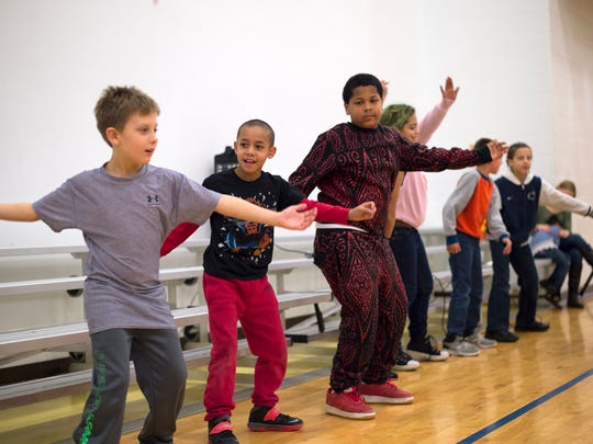 """Children do the """"Whip/Nae Nae"""" dance after a Thanksgiving meal at the Boys and Girls Club of Binghamton on Tuesday, Nov. 24, 2015."""