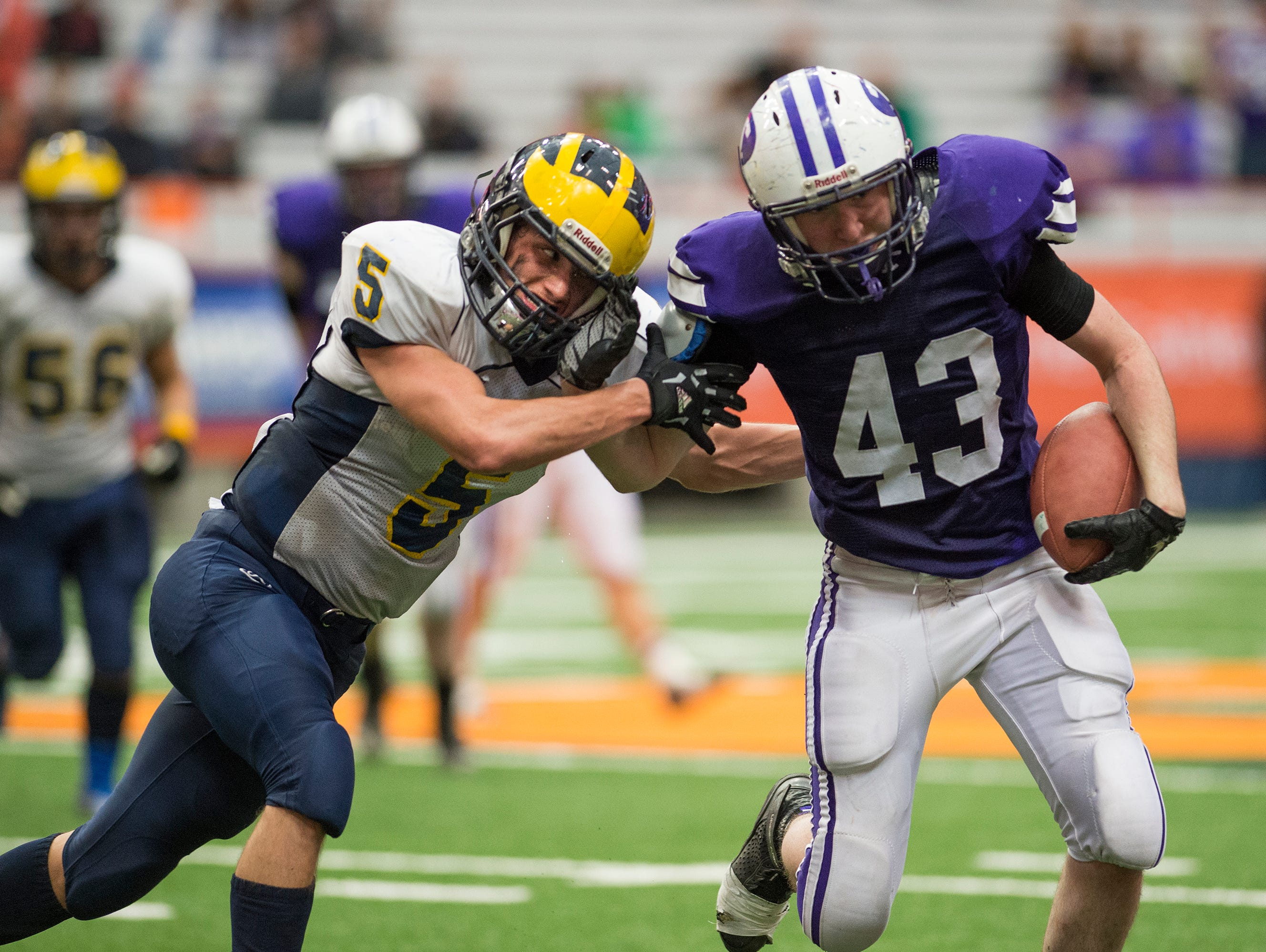 Tioga cornerback Jake Lewis tackles Ticonderoga tight end Jacob Spaulding during the fourth quarter of Tioga's 33-26 win in the 2015 Class D State Championship in Syracuse on Friday, Nov. 27, 2015.