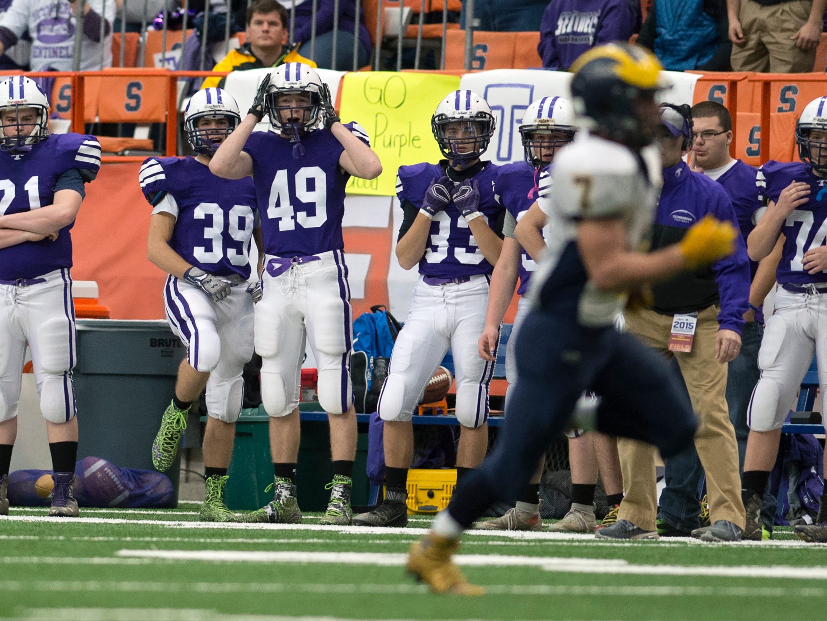 Ticonderoga players watch as Tioga runningback Jesse Manuel scores a touchdown during the first half of the 2015 Class D State Championship in Syracuse on Friday, Nov. 27, 2015.