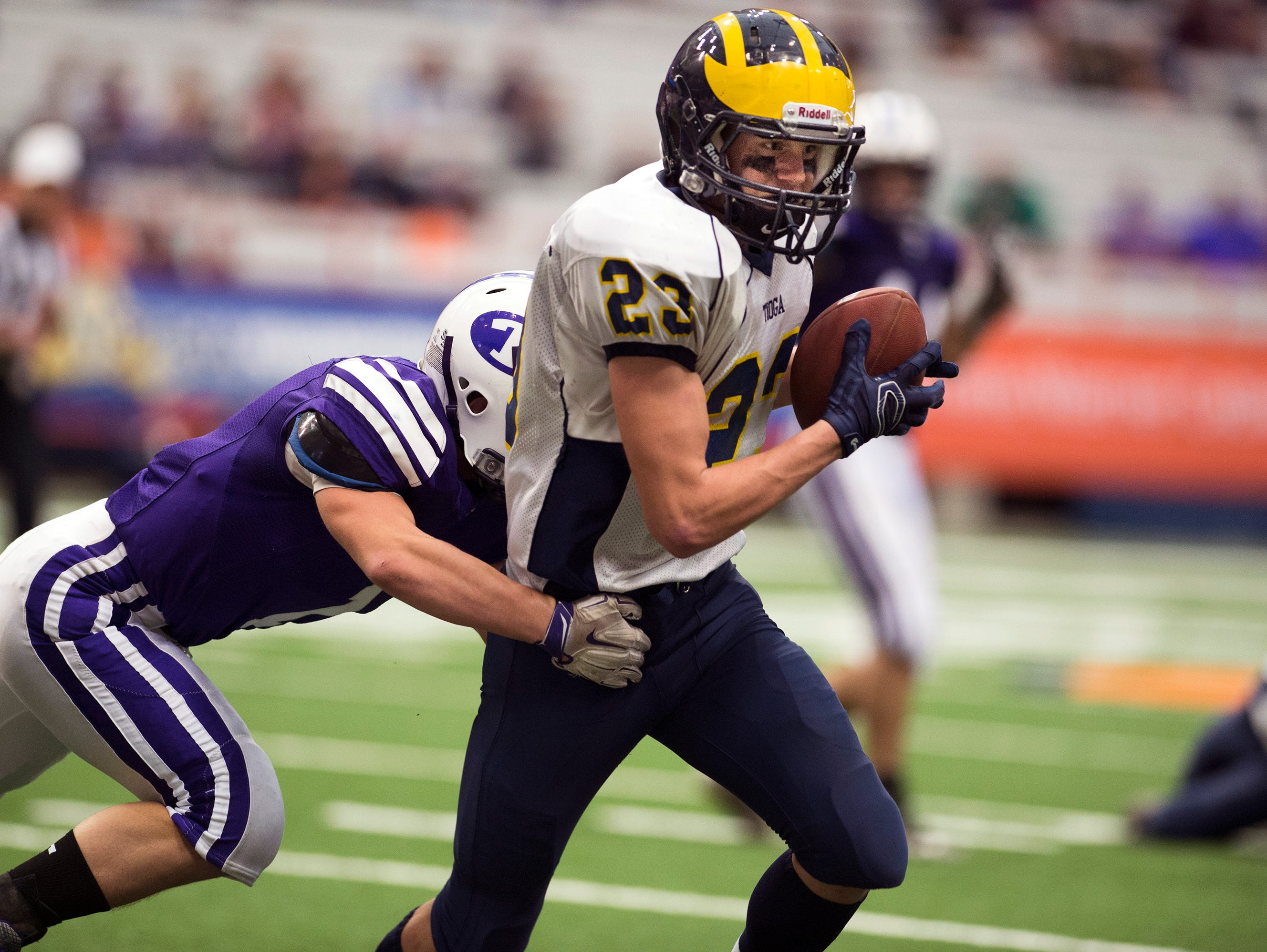 Tioga running back Tyler Whitmore hauls in a pass during the third quarter of the Tiger's 33-26 win over Ticonderoga in the Class D State Championship game in Syracuse on Friday, Nov. 27, 2015.