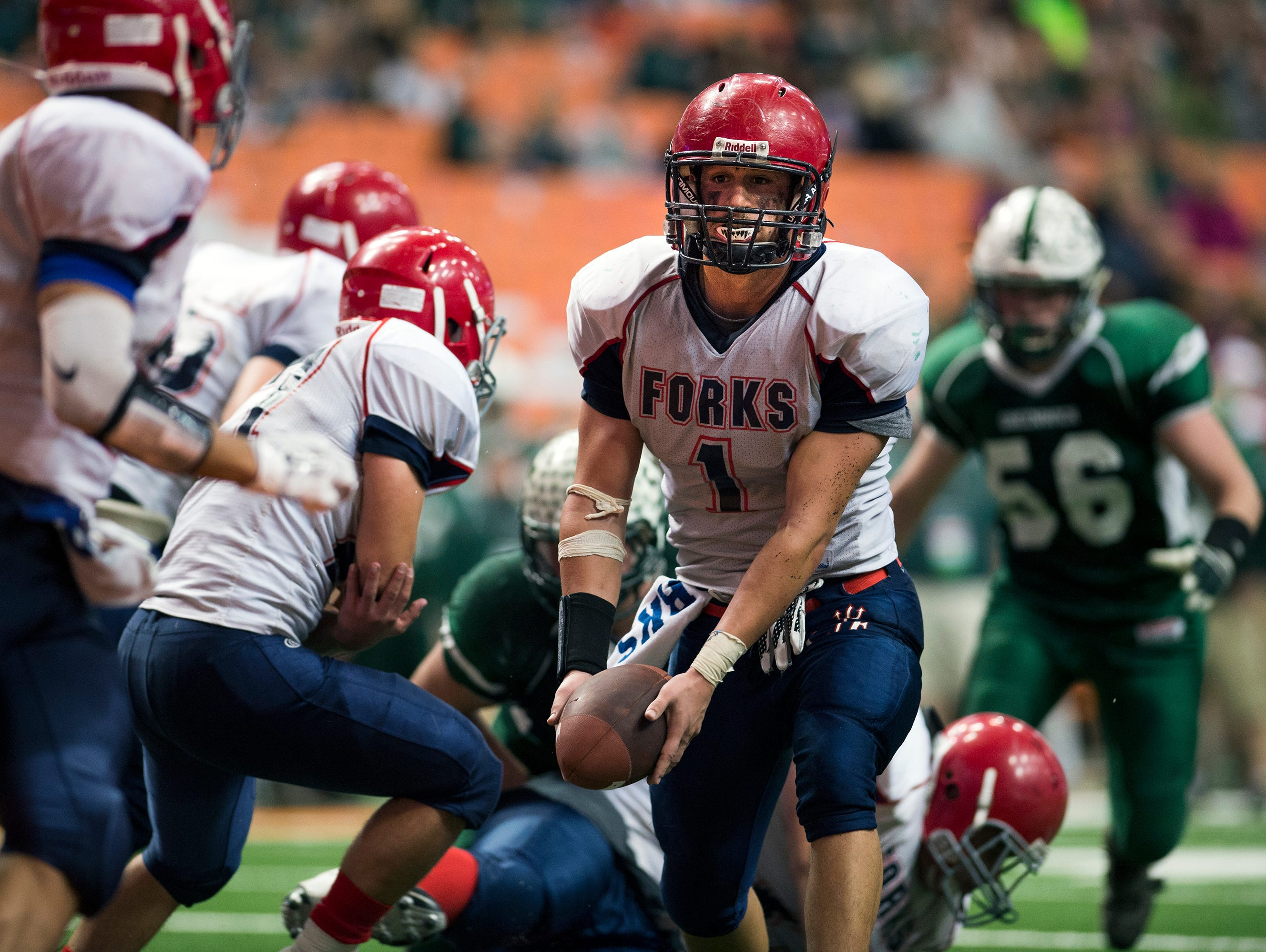 Chenango Forks quarterback Tony Silvanic pitches the ball during the Blue Devil's 42-7 win over Greenwich to win their third straight Class C state championship on Friday, Nov. 27, 2015 in Syracuse.