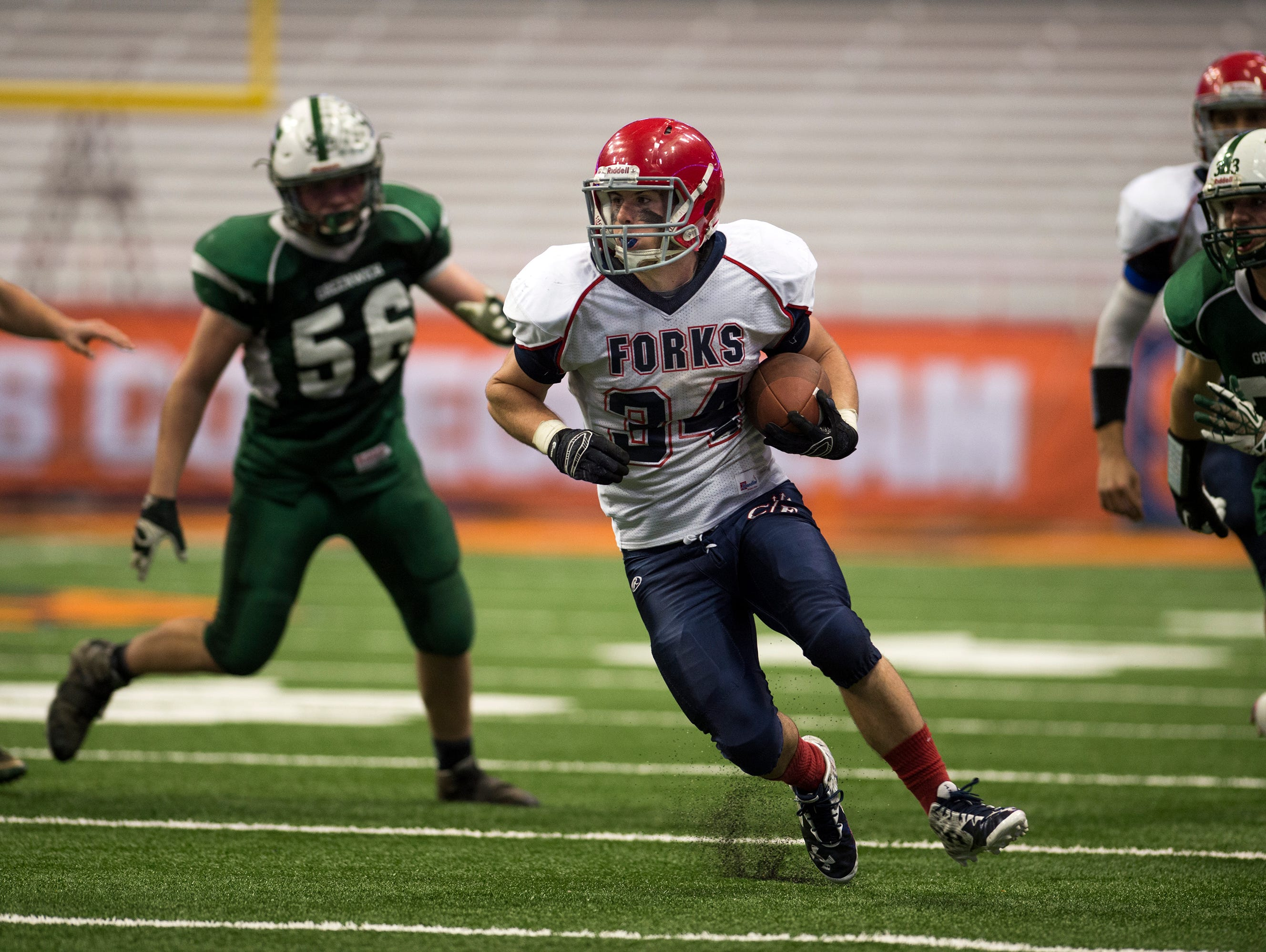Chenango Forks running back Cody Lamond rushes the ball during the fourth quarter of the Blue Devil's 42-7 win over Greenwich in the Class C state championship in Syracuse on Friday, Nov. 27, 2015.