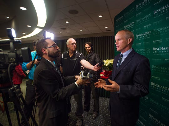 Binghamton University President Harvey Stenger speaks to the media after it was announced the Southern Tier will receive $500 million in state funding.