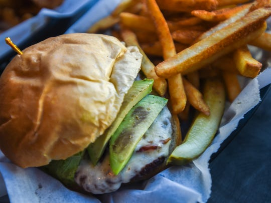 The Hub Habit burger at the Hanover Hub is topped with bacon, sliced avocado, lettuce, tomato and provolone.