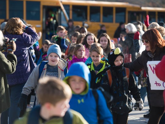 Owego Elementary students enter the school's new building