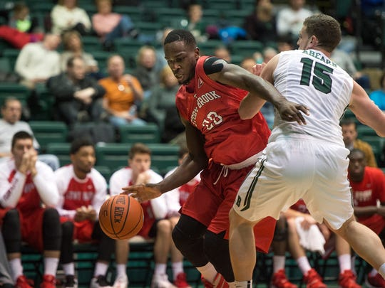 Stony Brook forward Jameel Warney drives past Binghamton