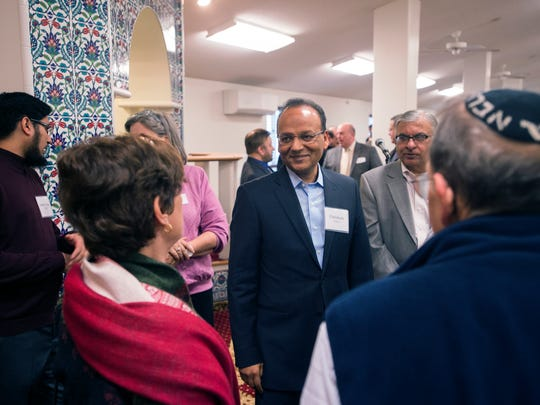 Ehtisham Siddiqui, president of the Islamic Organization of the Southern Tier, speaks to local religous leaders during Saturday's open house event at the organziation's mosque in Johnson City.