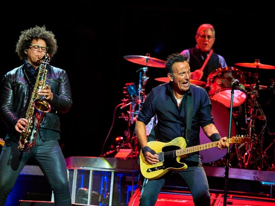 Bruce Springsteen, center, Max Weinberg, and Jake Clemons, left, perform with the E Street Band at Madison Square Garden, Wednesday, Jan. 27, 2016, in New York City.