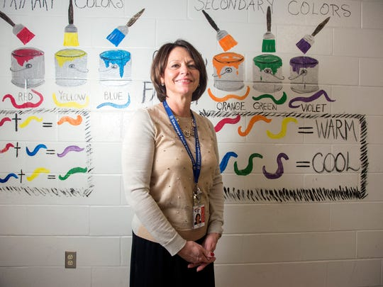 Chenango Forks Elementary art teacher Debra Abbey has taught in the district for over 20 years and spends time every summer decorating the hallways of the school.