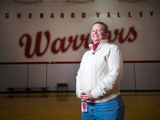 Sue Edwards, a gym teacher at Chenango Valley High School, also serves as the coach for the school's volleyball and softball teams.