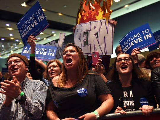 Supporters cheer while listening to Democratic candidate for President Bernie Sanders speak at the Reno-Sparks Convention Center in Reno on Feb. 13, 2016.