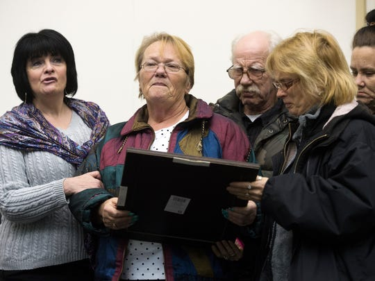 "Members of Bambi Madden's family and Debra Wilson, pastor of Comfort Ministries, left, are presented a proclamation designating Jan. 11 as ""Bambi Madden Day"" in the City of Binghamton on Wednesday."