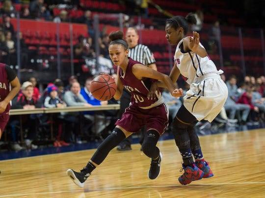 Elmira guard Kiara Fisher drives into the paint against Binghamton during Binghamton's 57-30 to win the Section 4 Class AA Championship at Floyd L. Maines Veterans Memorial Arena on Thursday, Feb. 25, 2016.