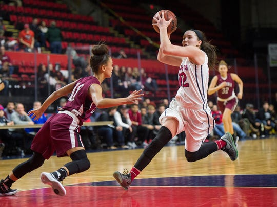 Binghamton guard Lauren McPeek drives into the paint during the Patriot's win over Elmira 57-30 in the Section 4 Class AA Championship at Floyd L. Maines Veterans Memorial Arena on Thursday, Feb. 25, 2016.