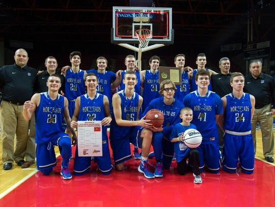 Horseheads players pose for a photo after beating Elmira