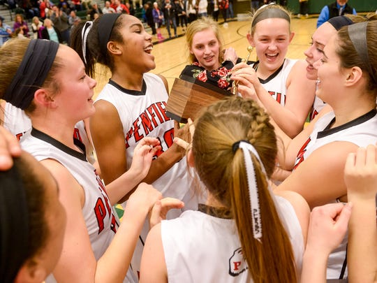 The Penfield girls basketball team celebrates after winning the 2016 Section V Class AA championship.