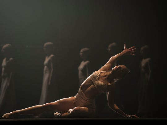 "Louisville Ballet dancer Kateryna Sellers in the premiere of choreographer Adam Hougland's ""Petrouchka"" with music by Igor Stravinsky in ""Spring Collaboration,"" a joint production of the ballet company and the Louisville Orchestra."