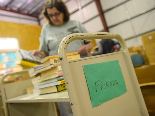 Lucy Wiley sorts through book donations for the semi-annual Friends of the Public Library book sale.