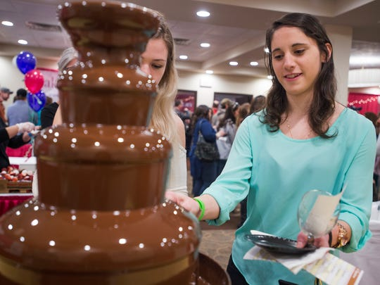 Andrea Deritis, of Binghamton, samples the chocolate fondue at the Binghamton Wine and Chocolate Festival at the DoubleTree in downtown Binghamton on Saturday.