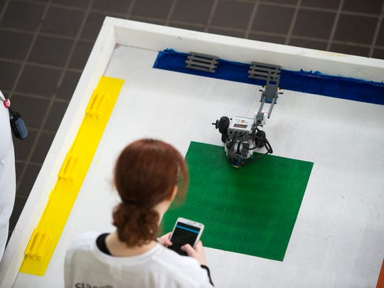 A student pilots their robot while competing in the
