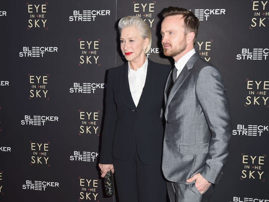 "Actors Helen Mirren and Aaron Paul attend the ""Eye In The Sky"" New York Premiere at AMC Loews Lincoln Square 13 theater on March 9, 2016 in New York City."