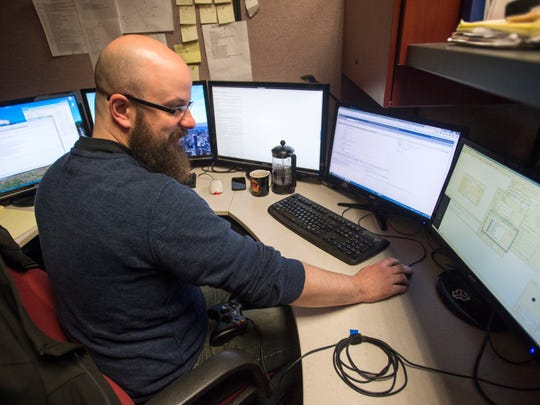 Jon Richards, quality lead at Vestal imaging company Diamond Visionics, works at his desk April 8. Richards tests renderings for bugs before they are presented to clients.