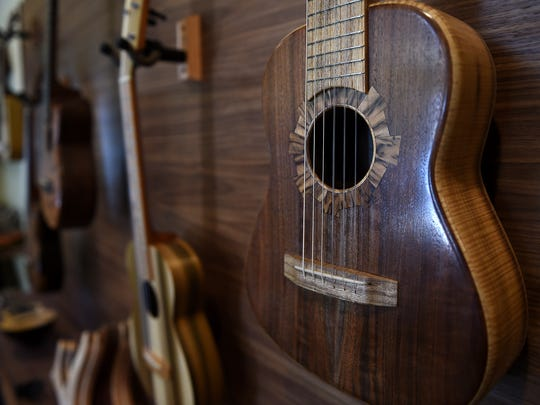 Custom ukuleles are seen at the TyDe Music studio in Kings Beach on April 4, 2016.