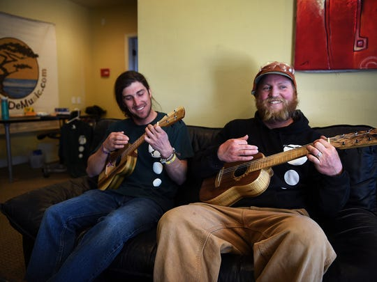 Luthiers Tyler Joersz, left, and Devin Price play a couple of their custom ukuleles at the TyDe Music studio in Kings Beach on April 4, 2016.