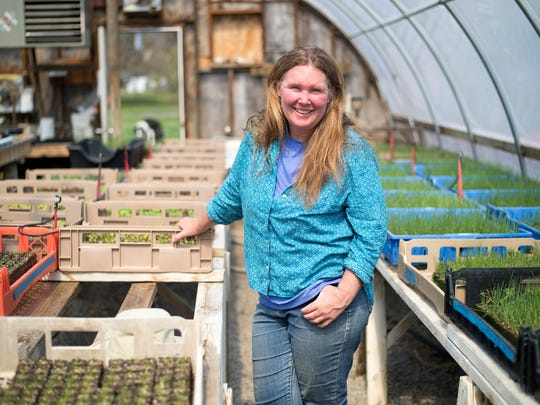 Lisa Bloodnick inside the greenhouse on her Apalachin farm.
