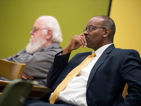Dr. Craig Jefferson, of Binghamton, listens as the results of a NIOSH study of birth defects among children of former Endicott IBM employees are discussed at George F. Johnson Memorial Library in Endicott on Thursday, May 26, 2016.