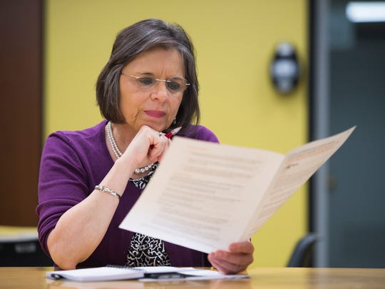 Assemblywoman Donna Lupardo reads a pamphlet regarding the results of a NIOSH study of birth defects among children of former Endicott IBM employees are discussed at George F. Johnson Memorial Library in Endicott on Thursday, May 26, 2016.