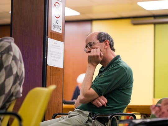 Broome County Health Department employee Ron Brink listens as the results of a NIOSH study of birth defects among children of former Endicott IBM employees are discussed at George F. Johnson Memorial Library in Endicott on Thursday, May 26, 2016.