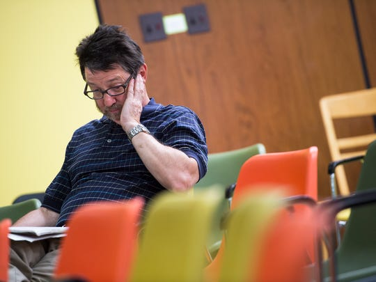 Former IBM employee Scott Lauffer, of Binghamton listens as the results of a NIOSH study of birth defects among children of former Endicott IBM employees are discussed at George F. Johnson Memorial Library in Endicott on Thursday, May 26, 2016.