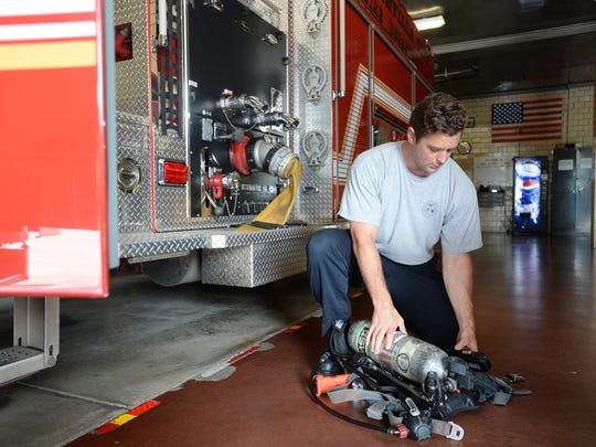 Casey Wickline, a Greenville City firefighter, works his last shift Thursday before leaving for summer training with the national bobsled team.