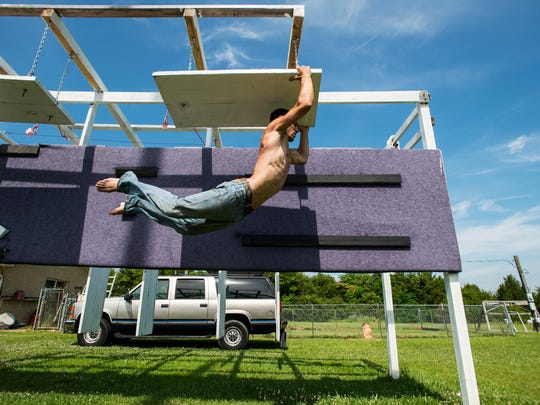 "Casey Suchocki, 24, trains on his homemade obstacle course in his grandfather's backyard on Tuesday, May 24, 2016 in Hope Hull, Ala. Suchocki recently competed in Season 8 of the television show ""American Ninja Warrior,"" which premieres on June 1."