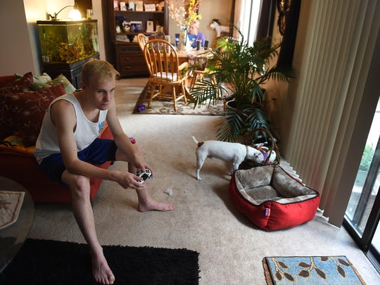 Zach Hanham plays a video game in his home in northwest Reno on July 15, 2015.