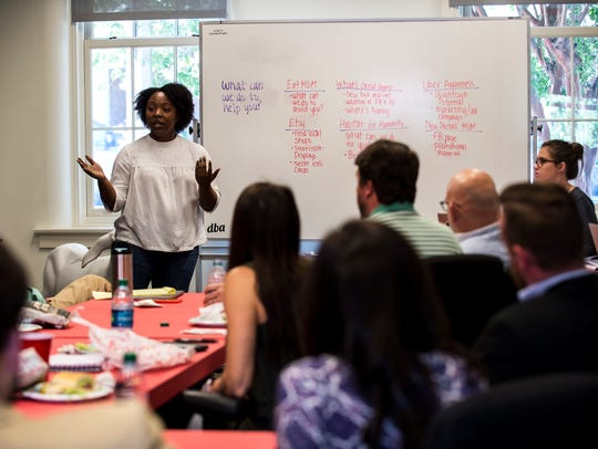 Alysheia Gray speaks during the first meeting of the