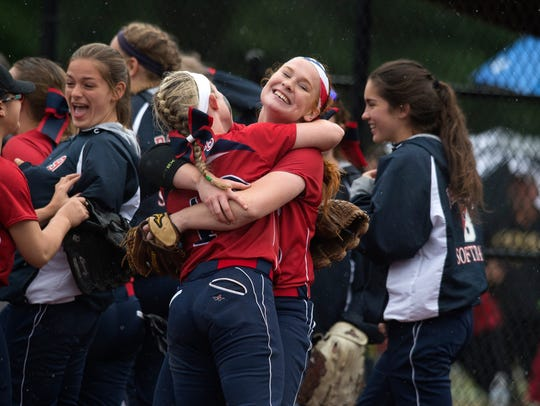 Binghamton pitcher Paige Rauch hugs a teammate after the Patriots defeated MacArthur 4-3 in a 2016 Class AA state softball semifinal at South Glens Falls. Rauch went on to lead the Patriots to the program's first state championship.