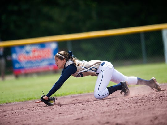 Elmira Notre Dame shortstop Alivia Clark makes a diving catch to end the top of the fourth inning during the Class C state softball title game against Cal-Mum on Sunday. Notre Dame won the game 8-6.