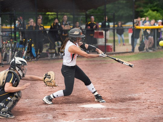 Marlboro High School's Ashley Votta hits a game-winning single in the bottom of the seventh inning against Windsor in the Class B state title game on Sunday In South Glens Falls.