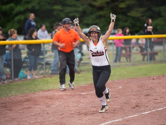 Marlboro High School's Taylor Felicello celebrates as she runs home to score the winning run in the Class B state title game on Sunday against Windsor.