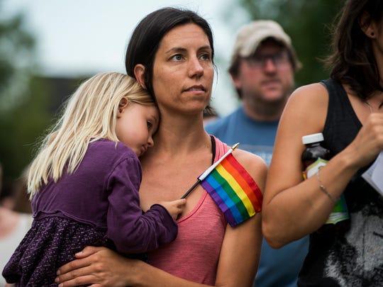 Kirsten Bokenkamp holds her daughter Zinn, 4, during