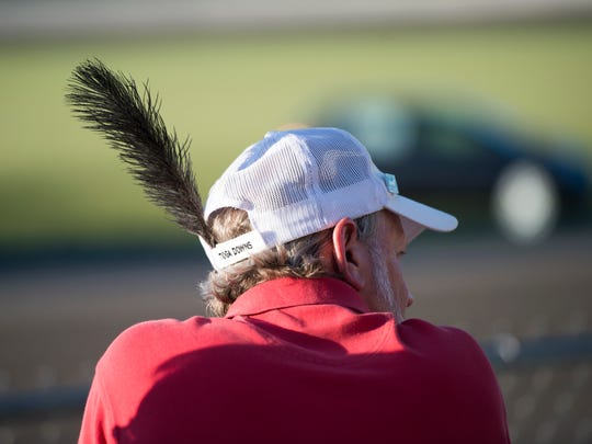 Sayre resident Chris James wears an ostrich feather in his cap following the race.