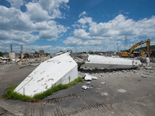 """The former Ken Wilson Chevrolet dealership was demolished on Saturday. The building, known as """"The Potato Chip"""" for it's unusual shape, was designed by James Mowry and opened as a dealership in 1964."""
