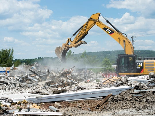 The former Ken Wilson Chevrolet dealership was demolished on Saturday.