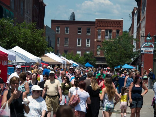 Crowds fill the street in Owego during last year's