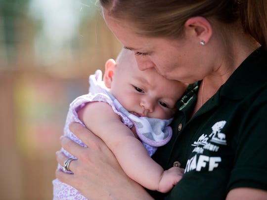 Colleen Patch holds her daughter Ava at the Animal Adventure Park. Ava was born with agenesis of the corpus callosum, a rare birth defect where the two hemispheres of the brain are not connected.