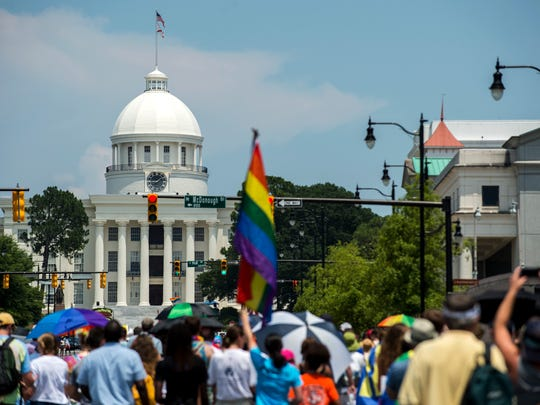 People approach the Capitol during the Montgomery Pride march on Sunday, Jun. 26, 2016 in Montgomery, Ala.